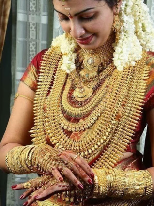 Indian woman with gold jewelry